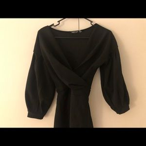 Black Nasty Gal mini dress with slit